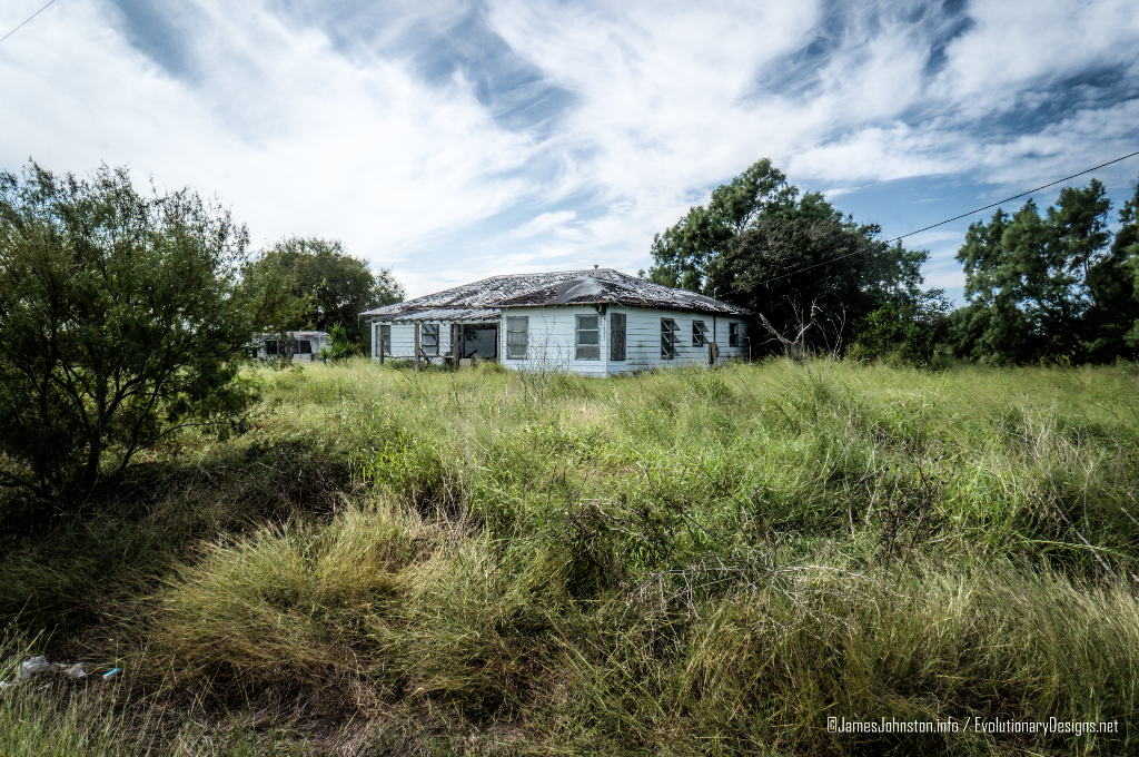 Two abandoned Farm Houses and old Ford Econline Motor Home Near West